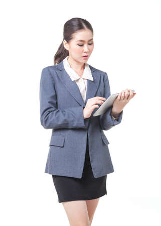 carreer: asian business women working with digital tablet. shot on white background