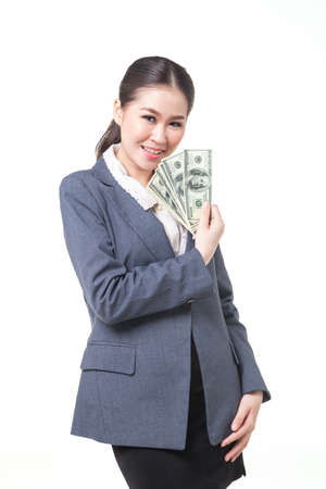 us dollar: asian business women hold US dollar bank note in hand. shot on white background