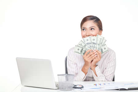 carreer: Asian business woman hold some of bank notes in hand with smiling face. isolated white Stock Photo