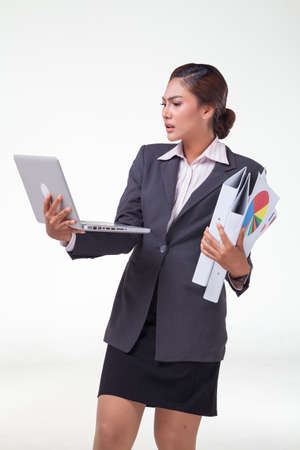 carreer: Business woman using laptop and hold files in another hand, working hard. Shot in white background