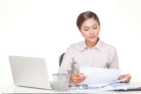 carreer: young business woman using laptop and working withdocument paper, isolated on white background