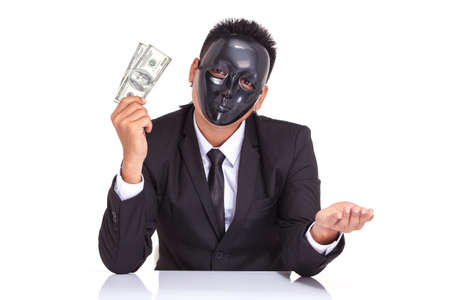 half lenght: businessman with black glossy fancy mask holding bank note