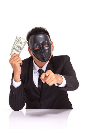 espionage: espionage businessman with black glossy fancy mask holding bank note Stock Photo