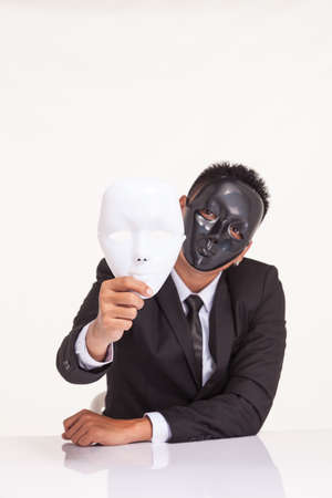 espionage: insincere espionage businessman swap the fancy mask