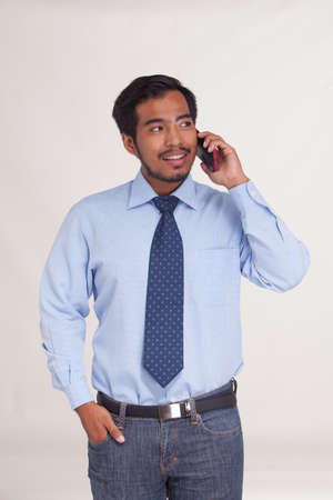american banker: Asian young businessman talk cellphone
