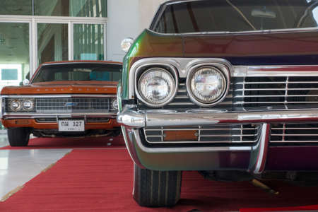 31st: SONGKHLA, THAILAND - MARCH 31st 2016: Meeting of classic american cars, in Hatyai Motor Show 2016, on March 31st, 2016. Double headlight in Chevrolet Impala, 327.