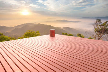 Wooden floor in beautiful resort terrace, Morning sunshine. Stock Photo