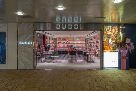 gucci store: Singapore - July 31: A Gucci outlet, July 31,2016, Changi International airport, Terminal 2, International departure, Singapore. Editorial