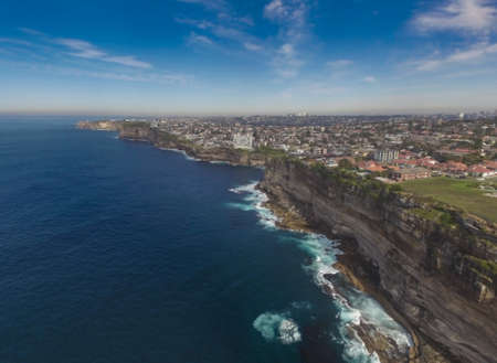 The beauty of the scenery along the cliffs. Sydney, Australia. This stunning view overlooking the quaint cliff, which is very beautiful. The beautiful city of Sydney and the lighthouse as a backdrop.