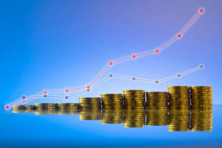 Gold coins stack on mirror with graph overlay. Business growth concept. Stock Photo
