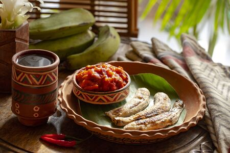 african food. African cuisine called Boli and sauce. fried bananas plantains. Grilled Bananas. African tourism
