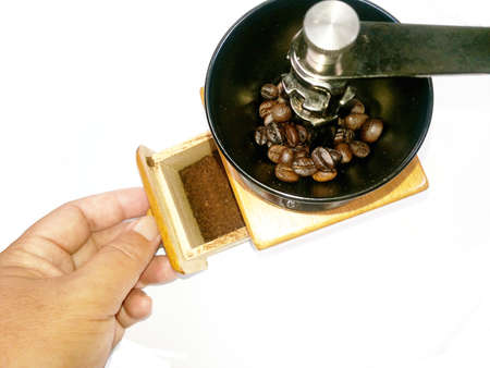 Coffee powder in drawer of manual coffee grinder Stock Photo