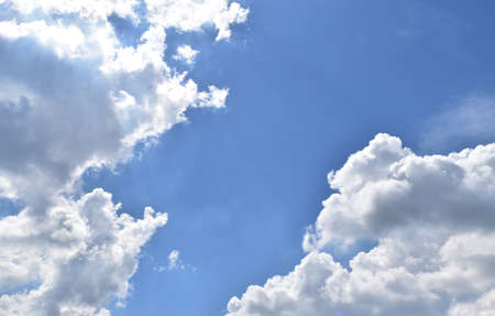 Troll pointed nose talking with the  man who has  pointed beard and cheeks puffed.,Cloud shaped like a human on blue sky