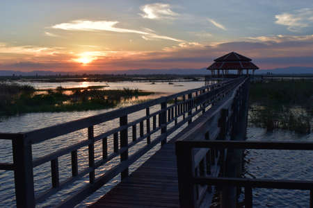 Sam Roi Yot National Park ,Wooden bridge and pavilion, The path on the lagoon,Wetland,Sky turn orange as a sunset reflecting on the water, Buang Bua , ,Thailand