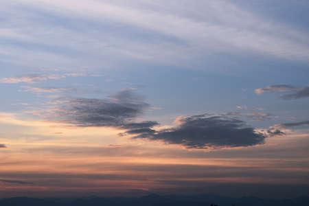 Beautiful cream color sky before sunset, Horizon began to turn orange with purple and dark cloud, Dramatic cloudscape area