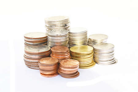 valued: Many stacks of coins in various sizes and valued,Business and finance