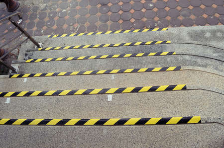Black and yellow stripes for safety symbol on the edge of the staircase, Warning sign the Ground level difference