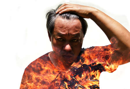 Double exposure of Asian men and flame, Fire erupts in the body of an angry man isolated on white background, Stress in the mind affects the body, Psycho savage human, Insanity face and fierce eye Stok Fotoğraf