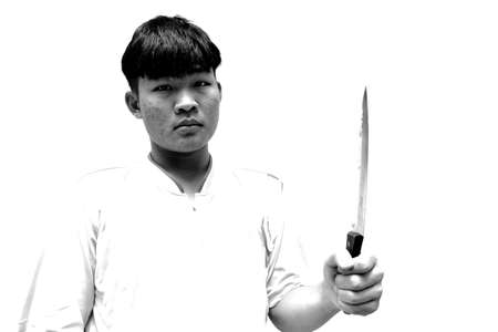 Asian teenage men in his hand holding a kitchen knife sharp and pointed on white background, Acne-prone face of adolescent male, Halloween horror concept Reklamní fotografie