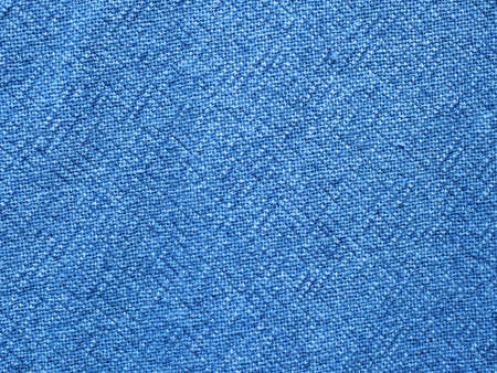 Blue color surface and grunge background of the fabric is old and torn, Textile texture for add text or graphic design