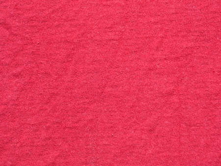 Red color surface and grunge background of the fabric is old and torn, Textile texture for add text or graphic design