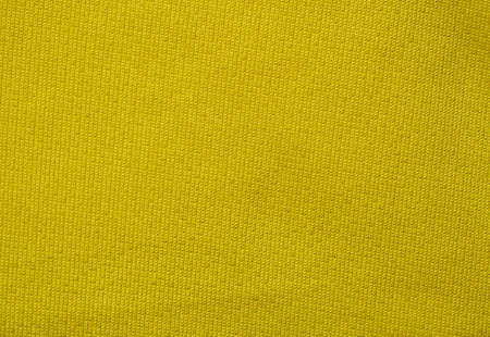 Yellow color surface and grunge background of the fabric is old and torn, Textile texture for add text or graphic design
