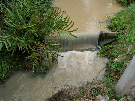 Turbid water in the check dam overflows into the spillway, Thailand