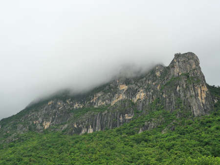Cloud and fog cover limestone mountain in the rainy season, Green forest and rock at Khao Sam Roi Yot National Park, Thailand