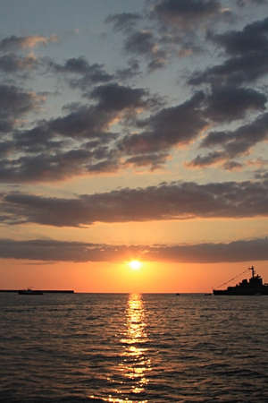 A powerboat running across the view of Black sea sunset