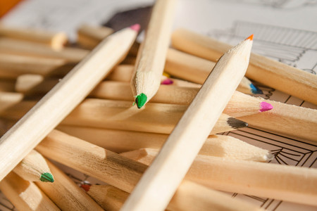 stres: Color wooden pencils and coloring sheets background