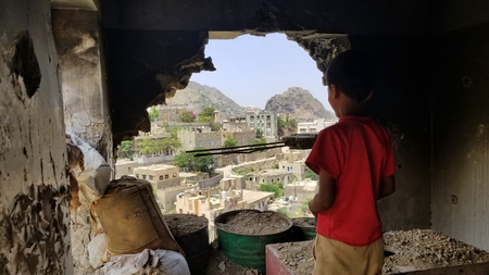 A child on the ruins of their house destroyed by the war in Yemen.