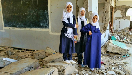 """""""Taiz / Yemen - Nov 21 2018: Students stand on their school, which was destroyed by the Houthis after they turned it into a military barracks."""""""
