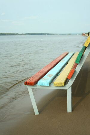 Colored bench on the beach on sunny day