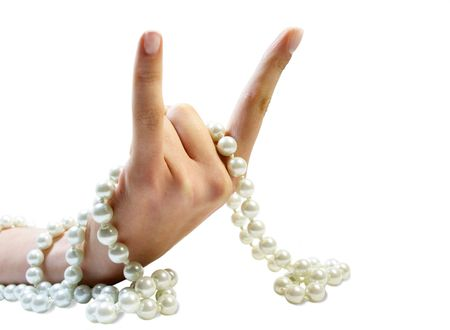 Isolated hand with bristling fingers and white beads Stock Photo