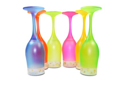 Six isolated colored tall wine glasses in semicircle