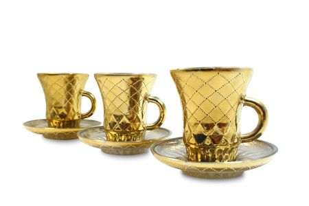 Three isolated gilt cups in a row