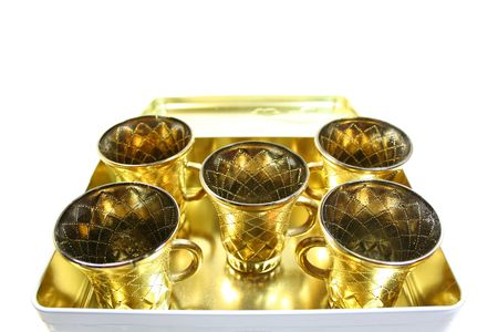 Five isolated gilt cups in a box Stock Photo
