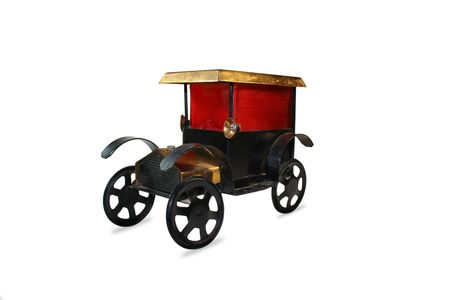 Isolated old tiny iron car with red frame