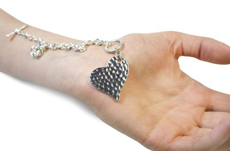 Isolated hand and silver heart
