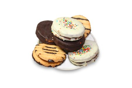 Isolated various types of cookies in saucer