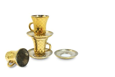 Two isolated gilt cups and two isolated gilt saucers