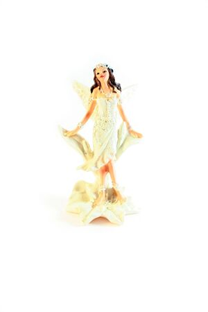 Figurine of an angel on white background