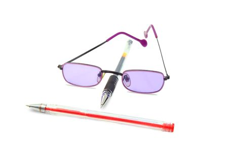 Isolated red and black pens and lilac glasses