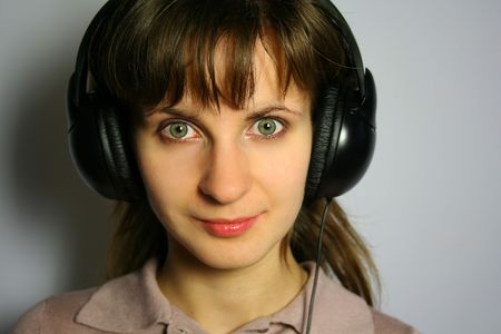 Woman with headphones is listening to music Stock Photo