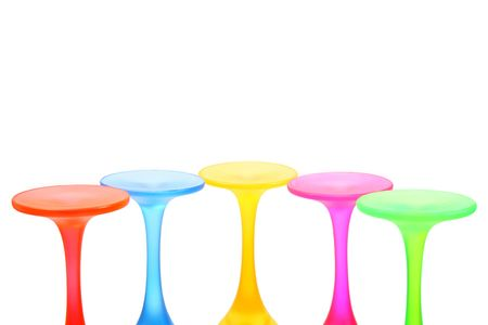 Five multicolored pedestals isolated on white