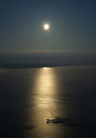 Full moon over the ocean with moon Stock Photo