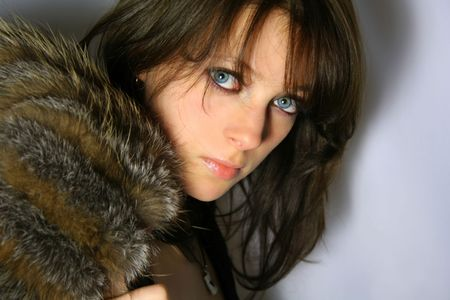 Young girl with blue eyes looks into camera Stock Photo - 2256821