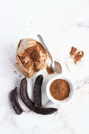 powder carob beans, bake ingredient for a natural healthy eating
