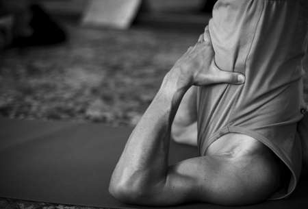 male arms doing yoga Stock Photo