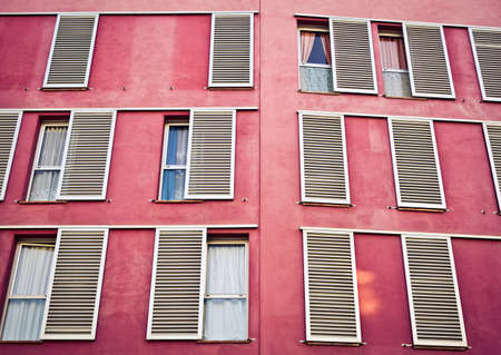 Windows on the pink wall